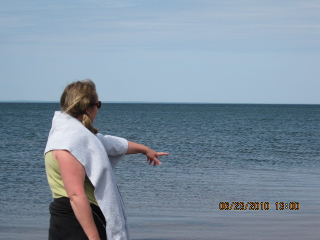 The Wife pointing out to sea